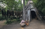 A wooden teepee and pelts hanging to dry are signs of early life at Old Fort William in Thunder Bay, Ontario in Canada.