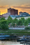Boats moor at the marina, people relax at the outdoor cafes and restaurants while others browse the shops which are all located at The Forks in the City of Winnipeg, Manitoba. The sunset hues are an added bonus while visiting The Forks.