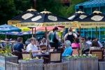 A terrace at an outdoor cafe at The Forks Market in the City of Winnipeg in Manitoba is a busy location during the summer months when people can enjoy the sun and the scenery.