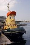 In the harbour in the downtown core of Halifax, Nova Scotia you can take a picture of the well known tugboat named Theodore.