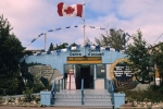 A Canada flag blows in the breeze above the visitor centre in Tobermory on the Bruce Peninsula in Ontario, Canada.