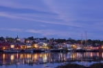 A beautiful evening of the town of Lunenburg reflect on the waters of the harbour.