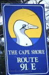 On your travel in Newfoundland, Canada you will pass this bright yellow, blue and white sign along The Cape Shore route.