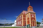The Parish Hall in the town of Trinity along the Discovery Trail in Newfoundland, Canada shows off its beautiful architecture during the daylight hours on a summer day.