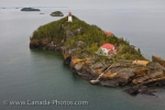 From the air, the scenery is amazing as you pass over Trowbridge Island and the lighthouse in the waters of Lake Superior in Thunder Bay, Ontario.