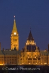 An evening view of Parliament Hill from Nepean Point in the city of Ottawa.