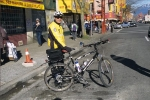 A sportive policeman with his bike in the Chinatown of Vancouver in British Columbia, Canada.