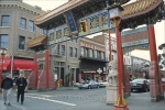 A decorative archway stands above the entranceway to Chinatown in Victoria on Vancouver Island in British Columbia, Canada.