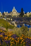 A beautiful city both by day and night, the inner harbour of Victoria, the Capital City of British Columbia, is punctuated by the illuminated Parliament Buildings as a backdrop. Seasonal flowers also adorn the waterfront.