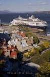 From the Terrasse Dufferin, buildings adorn the area of Old Quebec, Canada as a cruise ship docks along the waterfront at Vieux Port.