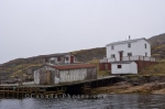 Fishing stages and a couple of houses sit along the banks of Wall Island in Southern Labrador in Labrador, Canada.