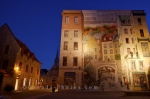 The lighting reflects off the beautiful wall mural, La Fresque des Quebecois, as darkness takes over in Place Royale in Old Quebec, Canada.