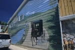 A wall mural on the side of a building represents the olden days in the town of Elmira, Ontario in Canada.