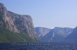 The sunlight glistens off the landscape of Western Brook Pond in Gros Morne National Park in Newfoundland Labrador.