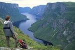 A woman takes in the magnificent scenery of Western Brook Pond in Newfoundland, Canada.