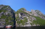 One of the boat tours on Western Brook Pond nears the Blue Denium Falls in Gros Morne National Park in Newfoundland Labrador in Canada.
