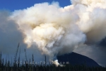 A wildfire well underway as the thick smoke fills the sky near Whitehorse in the Yukon Territories in Canada.