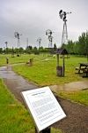 A sign at the Etzikom Museum in South East Alberta, Canada relates information about some of the windmills at this tourist attraction.