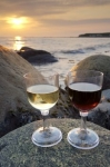 Large boulders along the rocky shoreline of Green Point in Gros Morne National Park in Newfoundland, Canada create the perfect wine glass holder.