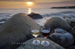 For lovers, the best place to enjoy some wine is on the coastal beach of Green Point in Gros Morne National Park in Newfoundland, Canada at sunset.
