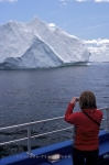 A large iceberg has made its way into Iceberg Alley in Newfoundland, Canada where a woman aboard the Gaffer III, an iceberg watching boat tour, takes passengers to view these natural wonders.