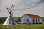 A teepee and an old building are two structures on display at the Wood Mountain Post Provincial Historic Park in Saskatchewan, Canada.