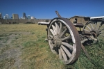 Old wooden wheels rest on the property of the Fort Calgary Historic Park in Calgary, Alberta in Canada.
