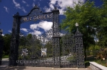 The wrought iron fence at the entrance to the Halifax Public Gardens in Halifax, Nova Scotia where the beauty of the gardens awaits the many visitors.