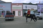 A Royal Canadian Mountie rides through the National Historic Site of the Klondike Gold Rush in Dawson City in the Yukon Territories.