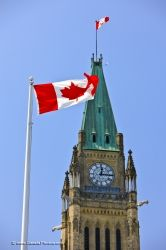 Canadian Flag In Front Of Peace Tower