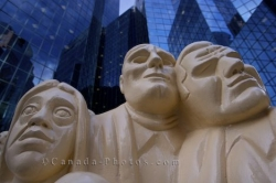 Illuminated Crowd Faces Downtown Montreal Statue
