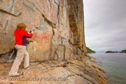 Tourist Photographing Agawa Rock Pictographs