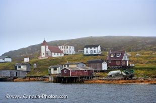 The historic village of Battle Harbour in Southern Labrador, Canada comes in to view as the ferry makes its crossing and the fog slowly lifts.