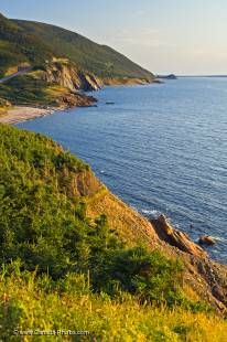Looping around the northern end of Cape Breton, the Cabot Trail takes in the beautiful coastal scenery of the Gulf of St Lawrence as well as many small communities and the Cape Breton Highlands National Park of Nova Scotia.