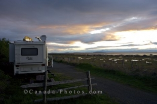 Sunsets over the Gulf of St. Lawrence are beautiful to sit and watch while camping in Kamouraska, Quebec in Canada.