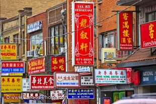In the city of Toronto, the buildings in Chinatown are covered with colorful street signs.