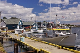 Fishing boats tied to the wharf line the harbour of the village of Rustico in Queen's country in Prince Edward Island, Canada.