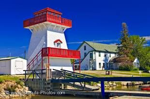 Bright white and red against a vivid blue sky, the lighthouse at the marina of Gull Harbour on Lake Winnipeg is an iconic symbol to leisure boaters in the area.