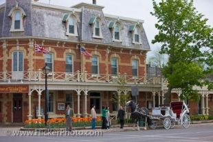 The Prince of Wales Hotel in Niagara-on-the-Lake in Ontario, Canada is located in the heart of this historic town. On a tour of the town, a horse and carriage stops to greet people in front of this historic building.