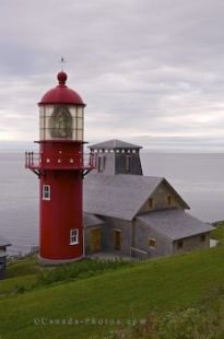 The Pointe a-la-Renommee Lighthouse is easily seen from the waters along the Gaspe Peninsula in Quebec, Canada due to its bright red hue.
