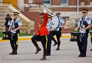 The procession leader takes the musical band through its routine at the Sargeant Major's Parade and Graduation Ceremony at the RCMP Academy in Regina, Saskatchewan.