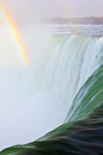 A double rainbows forms over the edge of Horseshoe Falls, Niagara Falls, Ontario, Canada
