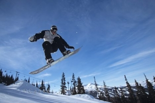 Great air time by this man snowboarding at Blackcomb Whistler in British Columbia, Canada.