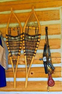 Photo of pair of snowshoes and a trap in the Warehouse/Barn at the Last Mountain House Provincial Park, Saskatchewan, Canada.