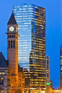 Photo of Clock Tower of the Old City Hall and a modern building in downtown Toronto at dusk, Ontario, Canada.