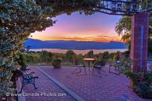 A cobbled outdoor patio close to Naramata is the perfect place to sit surrounded by a vineyard overlooking scenic Okanagan Lake at sunset while sipping on a glass of wine.