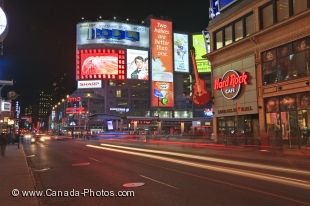 The night lights are aglow along Yonge Street, also known as Yonge Dundas Square, in the downtown area of Toronto in Ontario, Canada.