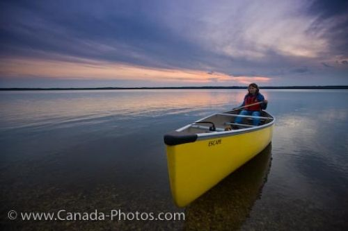 Photo: Lake Audy Sunset Woman Canoeing Riding Mountain National Park