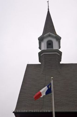 Photo: Memorial Church Bell Tower Acadian Flag Nova Scotia