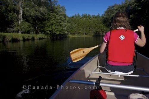 Photo: Mersey River Woman Canoeing Kejimkujik National Park